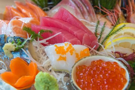 Salmon raw sashimi sushi with shrimp on plate, japanese food. Stock Photo