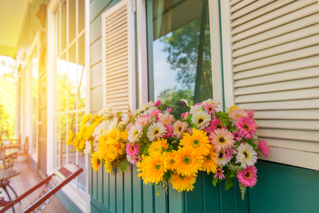 window with flower box and shutters at home.