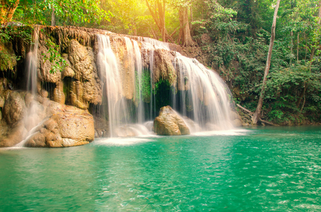 flowing water: Waterfall in Deep forest at Erawan waterfall National Park, Thailand.