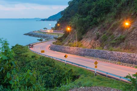 Beautiful curved road of the sea at Noen Nangphaya view point Chanthaburi, Thailand. Banco de Imagens