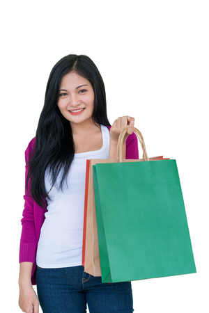 Shopping woman holding bags isolated on white background, consumerism, sale and people concept.