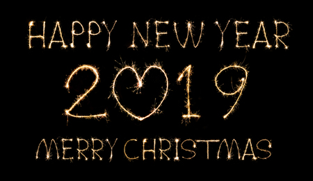 Happy New Year 2019 merry christmas text handmade written sparkles fireworks. Stok Fotoğraf - 117000001
