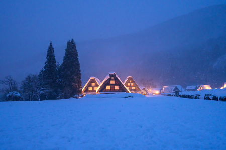 Snow falling on light Up Festival in winter at shirakawago Gifu Chubu Japan. Stock Photo