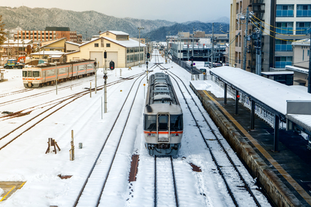 Train on the railway in snow day at Takayama Station,Japan. 写真素材
