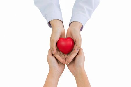 doctor hands holding red heart with patient isolated on white, health care love, give, hope and family insurance concept.