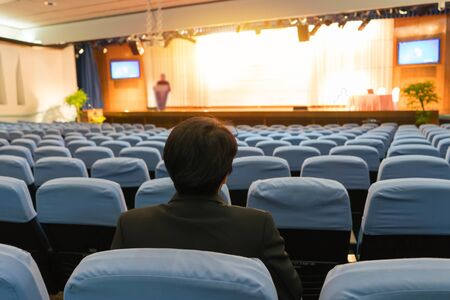 speaker prepares to lecture before people come meeting room. Фото со стока