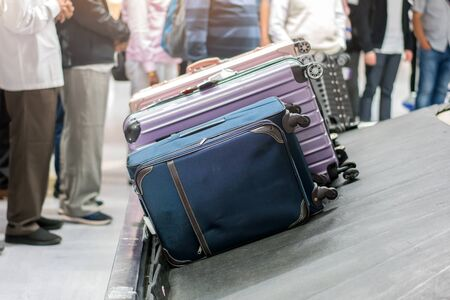 Suitcase or luggage with conveyor belt in the airport. Archivio Fotografico - 129138619