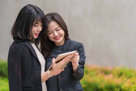 business woman working together with tablet at office building.
