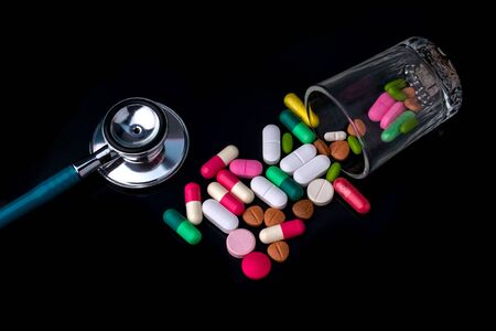 stethoscope and drug pill for doctor and medical nursing people check up healing of patients.
