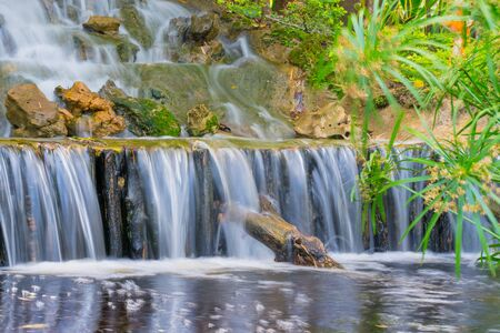 landscape of beautiful Waterfall in garden at public park.