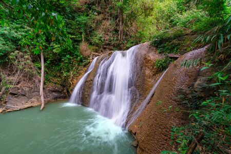 Waterfall in deep rain forest jungle (Thung Nang Khruan Waterfall) Thailand