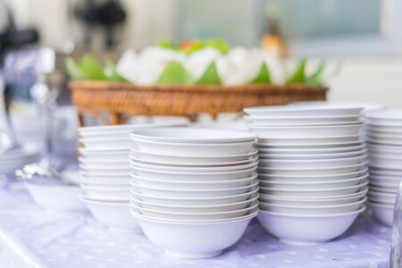 Set of dishes for dinner party at the banquet table.