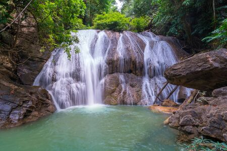 Waterfall in deep rain forest jungle (Thung Nang Khruan Waterfall) Thailand.