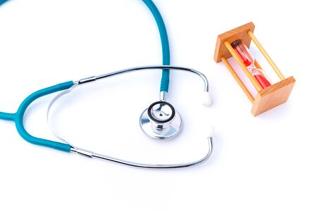 stethoscope and hourglass for doctor and medical nursing people check up healing of patients.