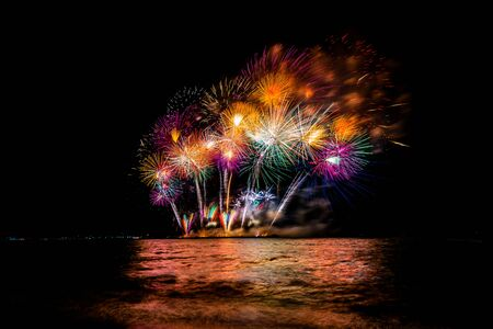 Beautiful colorful fireworks at night for celebration and anniversary or New year holiday concept.