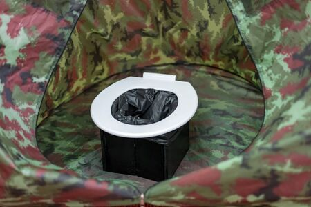 portable toilets in tent at camping public.