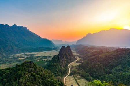 Top view of Beautiful Forest landscape of Sunset at pha Nam Xay Mountains Vang Vieng, Laos. Stock Photo