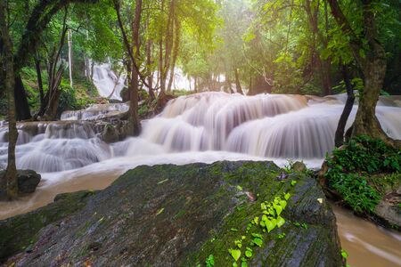 Waterfall scene at Pha Tad Waterfalls in rainforest  at the Khuean Srinagarindra National Park Kanchanaburi Thailand. Reklamní fotografie
