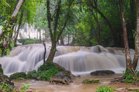 Waterfall scene at Pha Tad Waterfalls in rainforest  at the Khuean Srinagarindra National Park Kanchanaburi.
