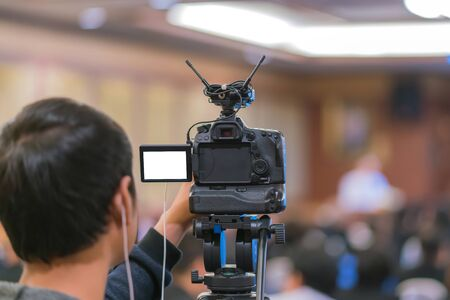 Cameraman taking Vedio to speaker on the stage present in conference hall or seminar meeting, event and seminar concept