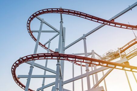 tracks of Roller coaster against blue sky, Perspective Concept