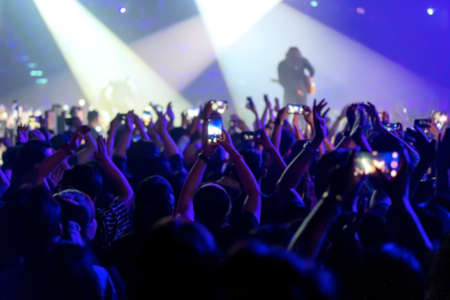 blur of People shooting video or photo in music brand showing on stage or Concert Live, party concept Banco de Imagens