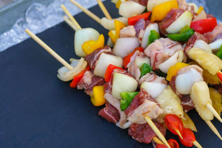 barbecued assorted delicious grilled meat with vegetable for family bbq party.