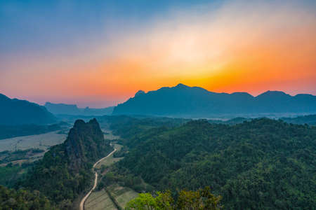Top view of Beautiful Forest landscape of Sunset at pha Namxay Mountains Vang Vieng, Laos