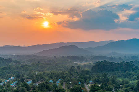 Landscape sunset of village in mountains at Thailand. Standard-Bild