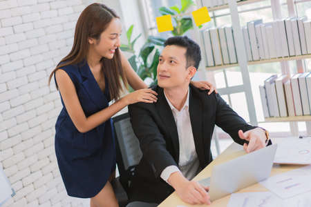 business man and secretary working together using laptop computer at modern office, Lifestyle business work at home concept.