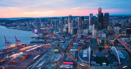 Seattle Washington USA - March 12 2018 Aerial View From Port of Seattle Shipping Yard Century Link Field Looking North Along Waterfront Spectacular Orange Sun Lighting Skyline Editorial