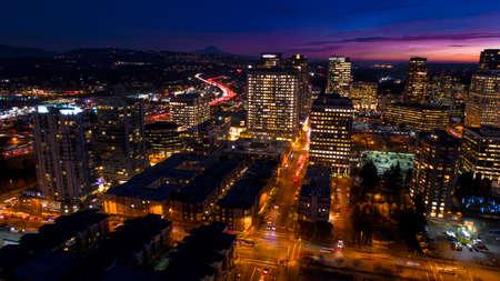 Bellevue Washington Aerial View at Night City Skyline Mount Rainier Background