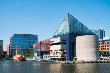 Baltimore, MarylandUSA - May 24, 2018: National Aquarium and Baltimore Maritime Museum Building Exterior View From Patapsco River Stock Photo