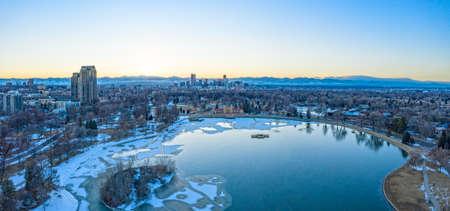 Denver Colorado City Skyline at Sunset Frozen Lake Snowy Winter Evening