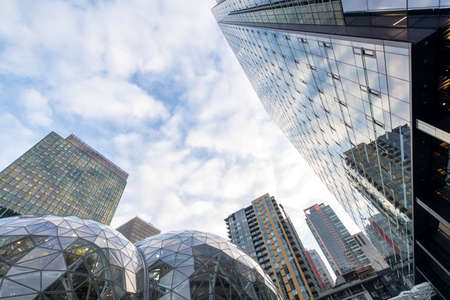Seattle, Washington USA - Dec 2, 2019: Creative Low Angle View of Amazon Headquarters Skyscraper and Spheres With No People