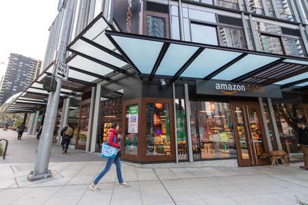 Seattle, Washington USA - Dec 2, 2019: People Walk Outside Amazon 4-Star Store on Westlake and Lenora