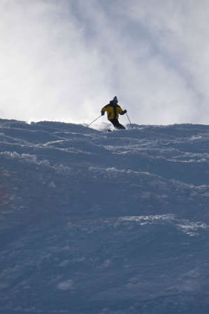 Yellow skier in powder snow,Mosettes - Cubere area,Chatel,French Alps,France