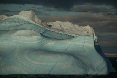 Iceberg with surrealistic blue swirls, Bransfield Strait,  Antarctica