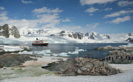 moving down: Cruise  tourists moving down to landing station, amid icebergs & glaciers  Petermann Island, Antarctica Stock Photo