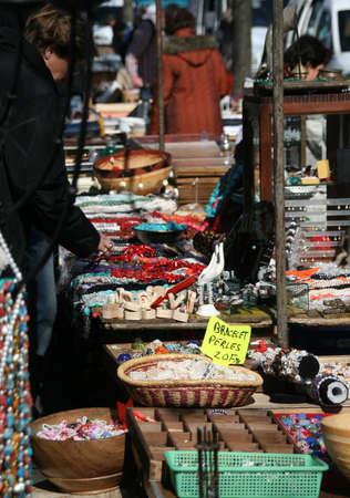 Woman buying beads and jewelry, Planpalais flea market, Geneva, Switzerland