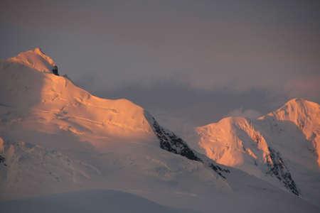 wilhelmina: Sunset highlights on steep mountain ridges and icefall,   Wilhelmina bay  Antarctica