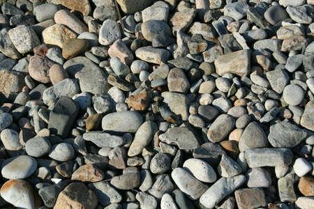 Granite pebbles, rounded by the ocean Acadia National Park, Mount Desert Island , Seawall Maine 版權商用圖片