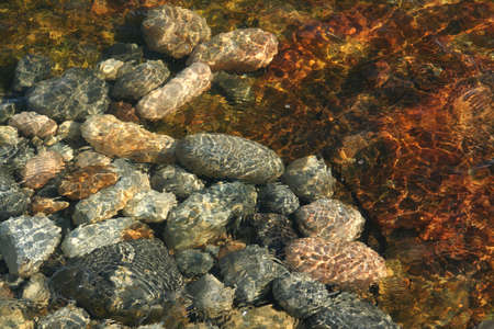low tide: Low tide ripples on pebbles Acadia National Park, Mount Desert Island , Seawall Maine