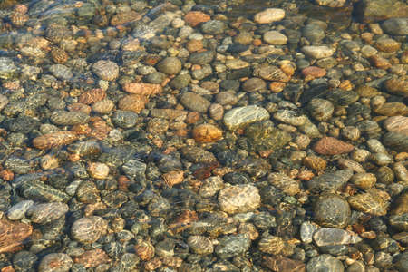 Low tide ripples, granite pebbles, rounded by the ocean