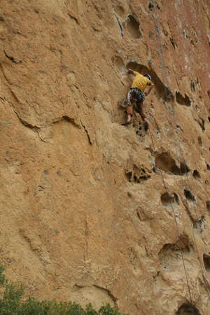climbers on rock face,