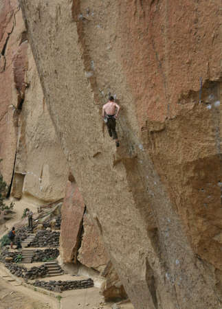Climber on overhanging cliff route,  Smith Rock State Park,  Central Oregon