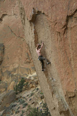 smith rock: Climber on overhanging cliff route,  Smith Rock State Park,  Central Oregon