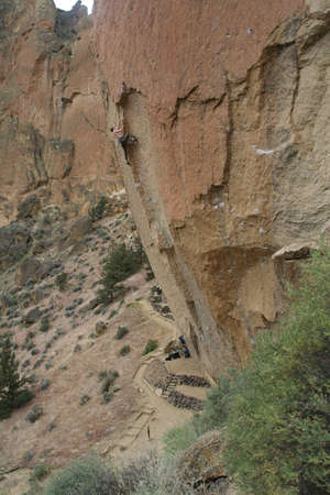 overhanging: Climber on overhanging cliff route,  Smith Rock State Park,  Central Oregon