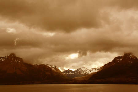 shadowy: Shadowy sepia ridges on overcast day,  Martinez Fjord,  Patagonia, Chile   Stock Photo