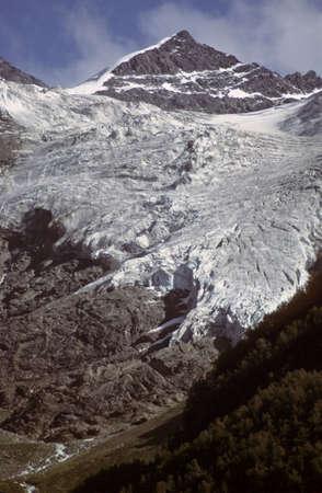 Mountain peak and valley glacier,  Caucasus, former USSR, now Georgia   版權商用圖片
